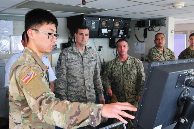 Spc. Yulin Ge, a watercraft operator with the 545th Transportation Company, briefs attendees of the Joint Senior Enlisted Logistics Forum aboard the Logistics Support Vessel 4 Lt. Gen. William B. Bunker January 31, 2018 at Joint Base Pearl Harbor-Hickam. The JSELF brought senior enlisted logistics leaders from all services together to enhance relationships in order to better organize joint capabilities. (U.S. Army photo by Sgt. 1st Class Michael Behlin)