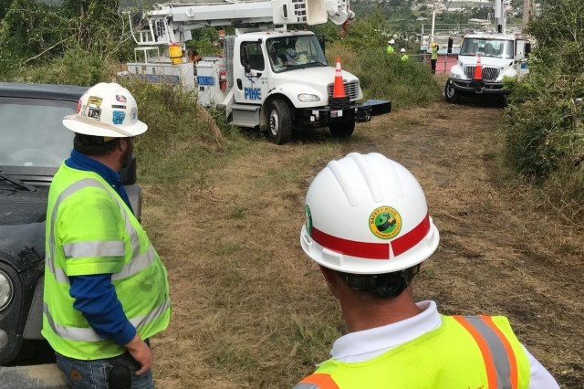 VIEQUES, Puerto Rico - The U.S. Corps of Engineers Task Force Power Restoration and contractors begin installing power lines on a hillside on the island of Vieques Jan. 29, 2018. In less than one month Cole, along with the contractors, have installed 100 power poles and six transformers on the island. (Photo by Robert USACE public affairs)
