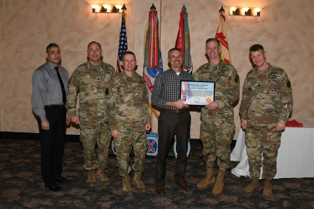 John Kadaraitis, the Civilian Workforce Development program manager, (center) is recognized as Civilian of the Year (FT17) by senior leaders during an awards luncheon Jan. 25 in the banquet room at The Commons.