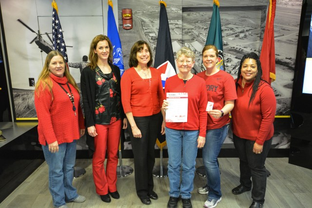 U.S. Army Sustainment Command personnel came to work donned in red to raise awareness for National Wear Red Day -- an American Heart Association campaign that raises awareness for preventing two leading causes of death among women, heart disease and stroke, here, Feb. 2.