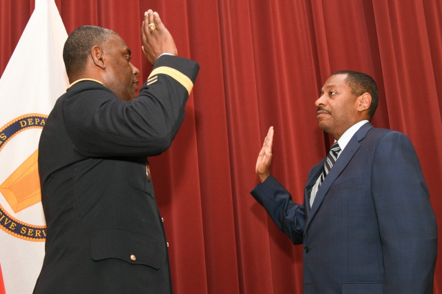 Major General Cedric Wins, commanding general of the U.S. Army Research, Development and Engineering Command, swears in Dr. Eric Moore as director of the U.S. Army Edgewood Chemical Biological Center.