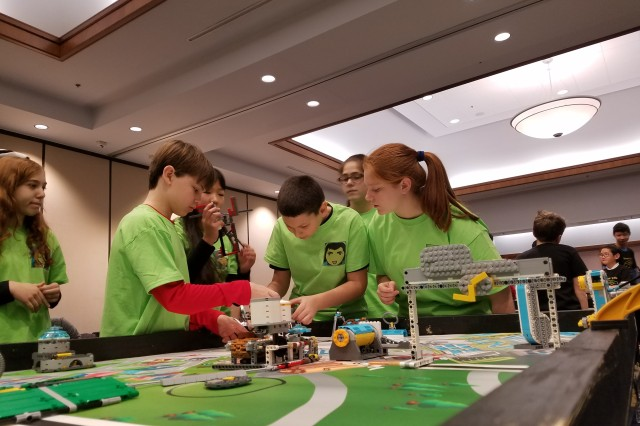 Team FLLow makes last-minute adjustments to their robot before the start of the FIRST LEGO League Maryland state qualifier tournament held at the Universities at Shady Grove in Rockville, Maryland, Jan. 6.