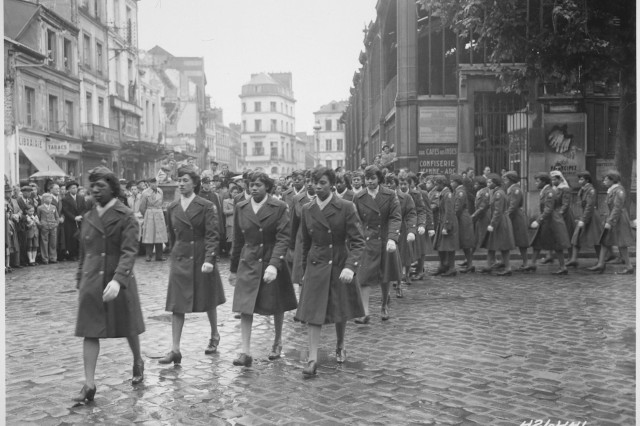 The 6888th Central Postal Directory Battalion, an all-black female unit of the Women's Army Auxiliary Corps consisting of 855 women, marches through Rouen, France in a victory parade at the end of World War II.