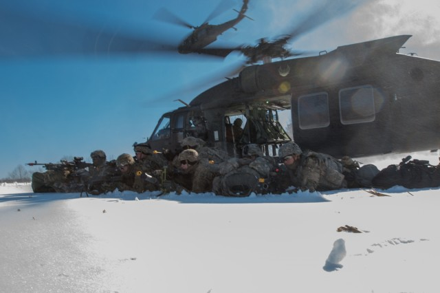 Soldiers from C. Company, 1st Battalion, 187th Infantry Regiment, 3rd Brigade Combat Team, 101st Airborne Division pull security after air assaulting out of a UH-60 Black Hawk January 18 on Fort Campbell.
