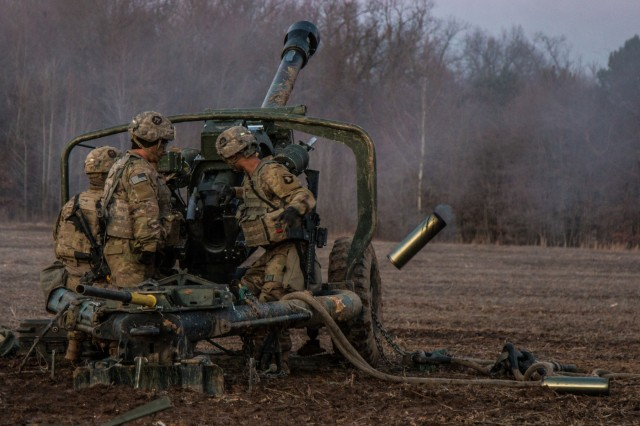 Artillerymen from B Battery, 3rd Battalion, 320th Field Artillery Regiment, 101st Airborne Division Artillery Brigade, 101st Airborne Division (Air Assault), fire an M119A3 Howitzer during platoon certification, January 24, at Fort Campbell, Kentucky. The Howitzers were sling loaded into place from three UH-60 Black Hawk helicopters.