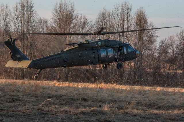 A UH-60 Black Hawk helicopter drops its sling load, an M119A3 Howitzer, at a firing point, January 24, at Fort Campbell, Kentucky. Sling loading the Howitzers allows the artillerymen to occupy remote locations more rapidly to effectively fire upon the enemy.
