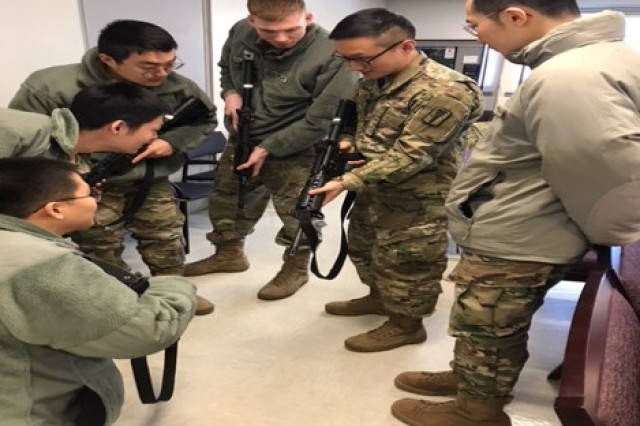 Soldiers of the 618th Dental Company gave a training session to their Korean Augmentation to the U.S. Army, or KATUSA, soldiers on how to perform a functions check on their M4 rifles.
