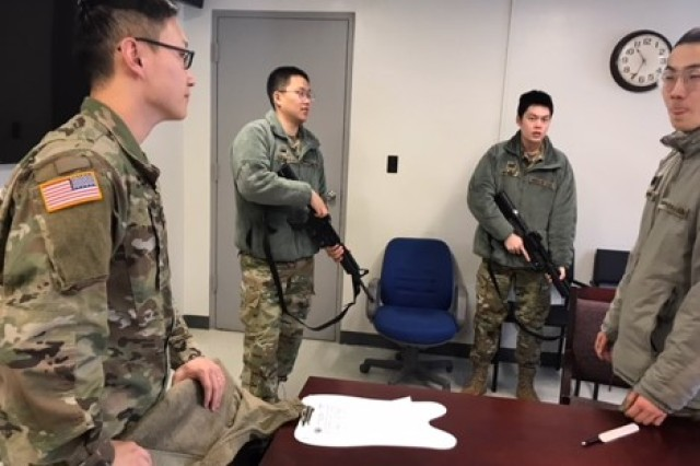 Korean Augmentation to the U.S. Army, or KATUSA, soldiers, demonstrate the knowledge learned during a training session taught by Soldiers of the 618th Dental Company on the M4 rifles.