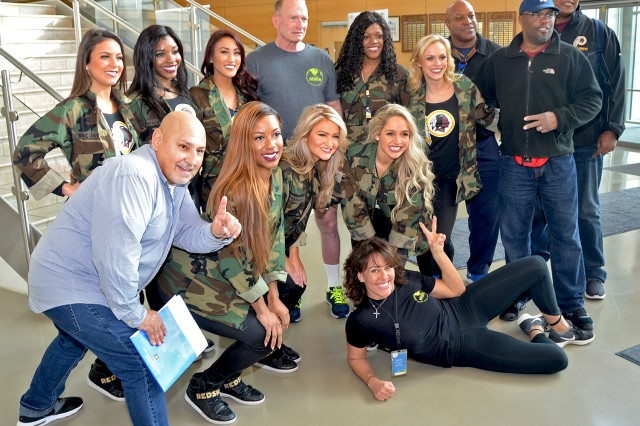 Washington Redskins Alumni and Cheerleaders pose for a photo with Wiesbaden military community members during a visit to the Wiesbaden Sports, Fitness and Outdoor Recreation Center Jan. 30, 2018.