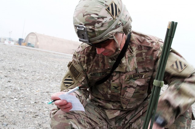 BAGRAM AIRFIELD, Afganistan - Col. Jeffrey Britton, commander of the 3rd Infantry Division Resolute Support Sustainment Brigade calls in a MEDEVAC request during a first aid training lane at Bagram Airfield, Afghanistan, Jan. 31. Six teams from across the RSSB competed in the event, which tested their physical and tactical skills, to celebrate the unit's 100th day in theater. (U.S. Army photo by Sgt. 1st Class Ben K. Navratil)