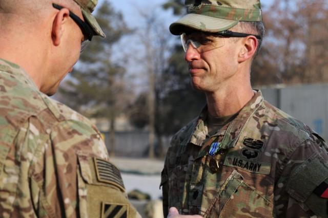"""BAGRAM AIRFIELD, Afganistan - Lt. Col. Michael Hagerty, commander of Special Troops Battalion, 3rd Infantry Division Resolute Support Sustainment Brigade, awards an Army Achievement Medal to Lt. Col. Jonathan Lloyd, commander of the 165th Combat Sustainment Support Battalion, 3rd Inf. Div. RSSB, at Bagram Airfield, Afghanistan, Feb. 2. Lloyd's team won the RSSB's """"100 Days In Theater"""" competition, which pitted six teams of Soldiers within the brigade against each other in physical and tactical tasks. (U.S. Army photo by Sgt. 1st Class Ben K. Navratil)"""