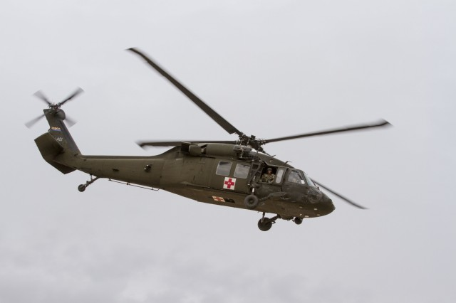 A medical evacuation UH-60 Black Hawk helicopter taking off after picking up a mock casualty from Florence Military Reservation, Jan. 20. MEDEVAC's are practiced so that Infantrymen know how to properly signal for aviation and load casualties under duress. Approximately 350 Soldiers participated in the air assault and an additional 300 Soldiers participated in roles within mission command supporting the exercise itself.