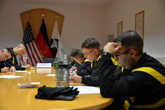 Soldiers write an Essay on a military topic during the USAMMCE/Public Health Command Europe Best Warrior Competition on Husterhoeh Kaserne, Jan. 29 -- Feb. 2.