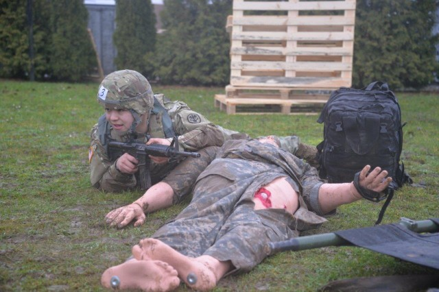Spec. Jose Luis Armendariz, PHA-Italy, moves under direct fire to treat a casualty during the USAMMCE/Public Health Command Europe Best Warrior Competition on Husterhoeh Kaserne, Jan. 29 -- Feb. 2.