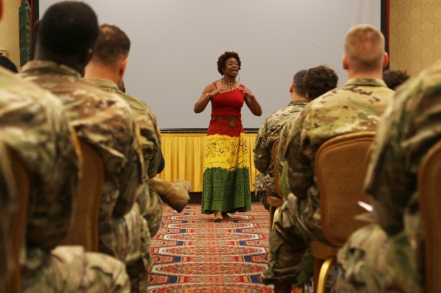 Warrant Officer Regina M. Crump, a human resource technician for Headquarters and Headquarters Battalion, 3rd Infantry Division Artillery and Detroit, Michigan, native, recites a poem during a Black History Month Observance at Club Stewart, Fort Stewart, Ga., Feb. 1, 2018. The observance was held to educate and acknowledge the United States military for the strides it has made for equal rights of black Soldiers. (U.S. Army photo by Pfc. Zoe Garbarino, 50th Public Affairs Detachment, 3rd Infantry Division public affairs)