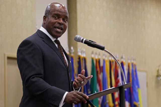 Kenneth Howard, the first black person to be appointed as the Hinesville, Georgia city manager, gives a speech during a Black History Month observance at Club Stewart, Fort Stewart, Ga., Feb. 1, 2018. Howard spoke about how far the military has come to create equal rights for all Soldiers serving. (U.S. Army photo by Pfc. Zoe Garbarino, 50th Public Affairs Detachment, 3rd Infantry Division public affairs)