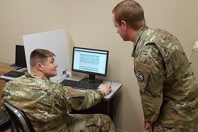 Idaho Army National Guard Soldier, Sgt. Charles Wical (right) helps Sgt. Seth Gaskins (left), complete his application for the Idaho Army National Guard State Education Assistance Program through the Guard Knowledge Online website. The state program pays up to $5,000 each year in tuition assistance and associated costs for Soldiers currently drilling in the Idaho Army National Guard and looking to attend any regionally or nationally accredited vocational school, college or university with a business office in Idaho.