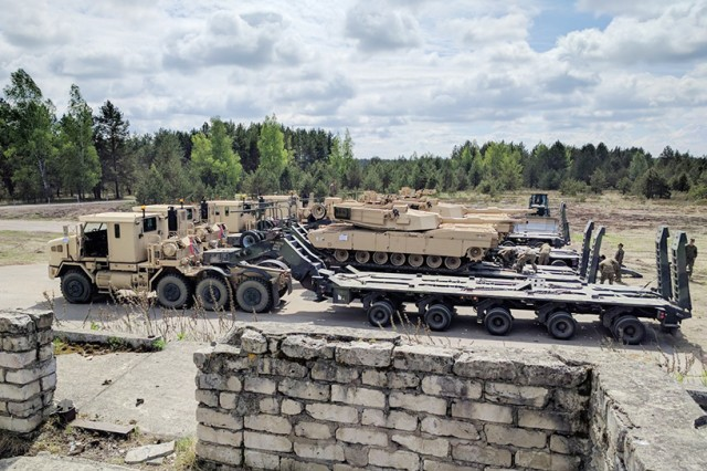 Heavy equipment transporters from the 32nd Composite Truck Company download Marine Corps heavy tracked vehicles at Adazi Training Area, Latvia, in support of Operation Saber Strike on June 2, 2017. This was the first time in history that Army platforms transported large-scale equipment across Latvia by road.