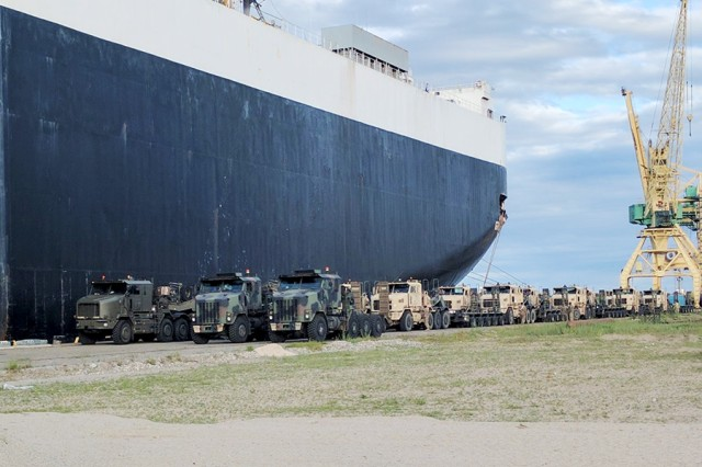 Heavy equipment transporters stage at the Port of Klaipeda, Lithuania, in preparation to load a combined arms battalion of heavy tracked vehicles on June 12, 2017. The 32nd Composite Truck Company line-hauled equipment across Lithuania in support of Operation Saber Strike, a multinational exercise that included a combined arms battalion emergency deployment readiness exercise and a port-to-fort movement within 72 hours.