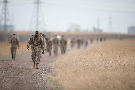 A Soldier participates in a road march at Erbil, Iraq, Jan. 6, 2018. The USO sponsored the Erbil Iron 12 mile road march to build cohesion with partner forces and to foster a healthy competitive nature.