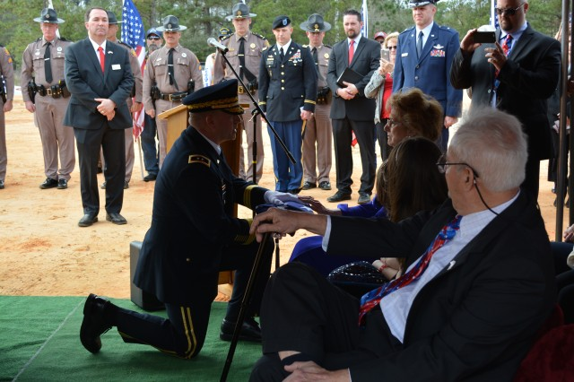 Maj. Gen. William K. Gayler, U.S. Army Aviation Center of Excellence and Fort Rucker commanding general, presents the Flag of the United States of America to Pamela Whitelock, the next of kin of World War II hero Lt. Ewart T. Sconiers at a repatriation ceremony in Defuniak Springs, Fla. Jan. 27.