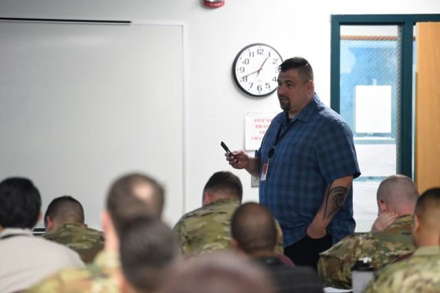 A physical security inspector, assigned to the 88th Readiness Division, discusses Risk Analysis during an Army Reserve Physical Security Workshop held at the Army Reserve's 85th Support Command headquarters, Feb. 6-7, 2018. The two-day workshop provided training to Soldiers on the physical security program, and assisted students in implementing security barriers to unit-assigned equipment and facilities. While the primary audience was made up of Army Reserve Soldiers assigned to the 85th Support Command, and operationally controlled by First Army, Soldiers assigned to Army Reserve commands across the country also participated in the training event. Completion of the training course certifies Soldiers as unit physical security officers. (U.S. Army Reserve photo by Anthony L. Taylor)