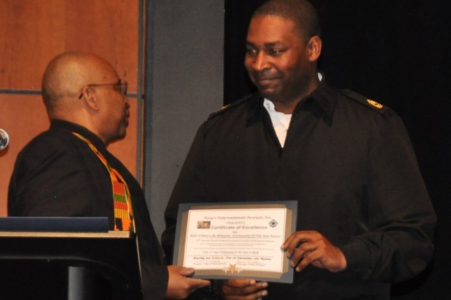 The Army Materiel Command's Master Sgt. Clifton Williams receives a Community of the Year award from program organizer Charley Douglas during the 16th annual Black History Enrichment and Enlightenment Festival Feb. 3 at Trinity United Methodist Church in Huntsville, Ala.