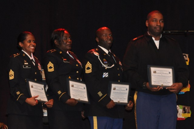 The Army Materiel Command's Master Sgt. Clifton Williams, far right, is recognized during the 16th annual Black History Enrichment and Enlightenment Festival for his efforts to include an arts educational program as part of Redstone Arsenal's cultural observances. Other Soldiers recognized at the Feb. 3 event in Huntsville, Ala., included, from left, Sgt. Maj. Willene Orr of the Army Materiel Command; Master Sgt. Carolyn Burnett of the Army Contracting Command and Master Sgt. Martinis Butler of the Space and Missile Defense Command/Army Forces Strategic Command.