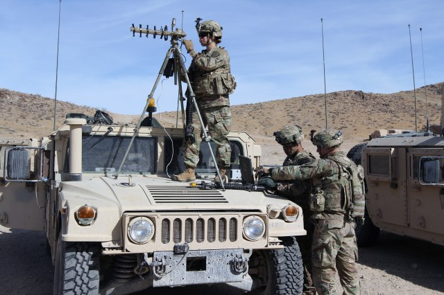 FORT IRWIN, Calif. -- Sgt. Camille Coffey (on the antenna), Spc. Victorious Fuqua (on the computer), and Spc. Mark Osterholt, all cyber operations specialists from the Expeditionary Cyber Support Detachment, 782nd Military Intelligence Battalion (Cyber), from Fort Gordon, Ga., provided offensive cyber operations as part of the Cyber-Electromagnetic Activities (CEMA) Support to Corps and Below (CSCB) program during the 1st Stryker Brigade Combat Team, 4th Infantry Division, National Training Center Rotation 18-03, Jan. 18 to 24.