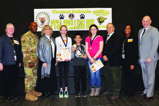 Spelling bee winners, principals and judges pose for a picture after the award presentation. From left to right: Allison Peltz; Capt. Ariel Castro; Noni Hoag; Asenath Wetzel, winner; Rion Buenavente, 3rd-place winner; Cheyenne Larson, 2nd-place winner; George Hanby; Tabitha Huewitt, middle school assistant principal; and Craig Cotter. See Flickr for more photos, www.flickr.com/usagvicenza.