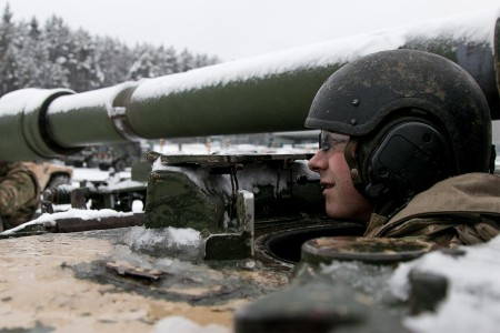 A Soldier assigned 1st Infantry Division, starts up his vehicle prior to the start of training at Hohenfels, Germany Jan. 22, 2018. The Soldier is among 4,100 troops from 10 nations participating in Allied Spirit VIII, a multinational training exercise designed to test participants' readiness and capabilities.
