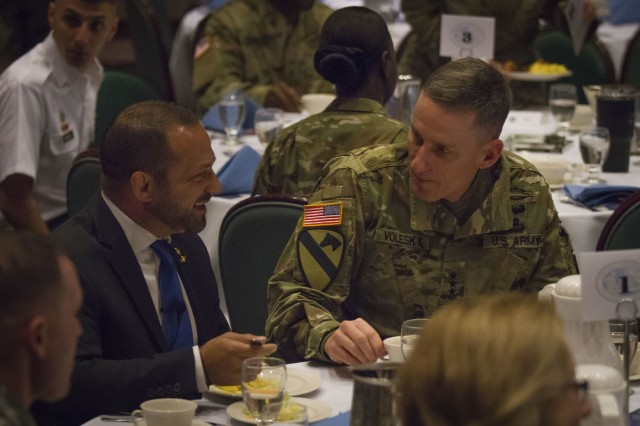 U.S. Army Lt. Gen. Gary Volesky, I Corps commanding general, and guest speaker Chad Robichaux, socialize during the 2018 Joint Base Lewis-McChord National Prayer Breakfast on JBLM, Wash., Feb. 2. The National Prayer Breakfast was established in 1953 to enhance resilience of Service Members and their families through spiritual readiness (U.S. Army photo by Pvt. Adeline Witherspoon, 20th Public Affairs Detachment)