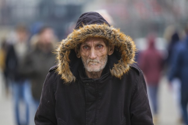 An elderly man wanders amid the final New Year's celebrations in Pristina, Kosovo, Jan. 4. In a city where most of the population is under the age of 25, the elderly man's haunting stare is a reminder of Kosovo's missing generation. (U.S. Army photo by Spc. Adeline Witherspoon, 20th Public Affairs Attachment)