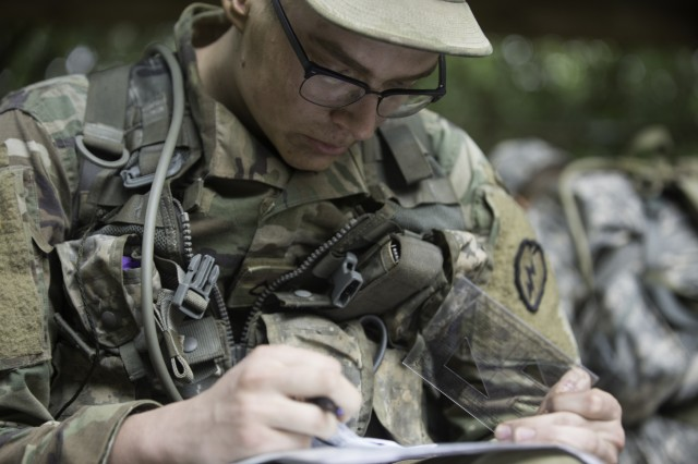 A Soldier conducts map work as part of the 25th ID Best FiST certification.