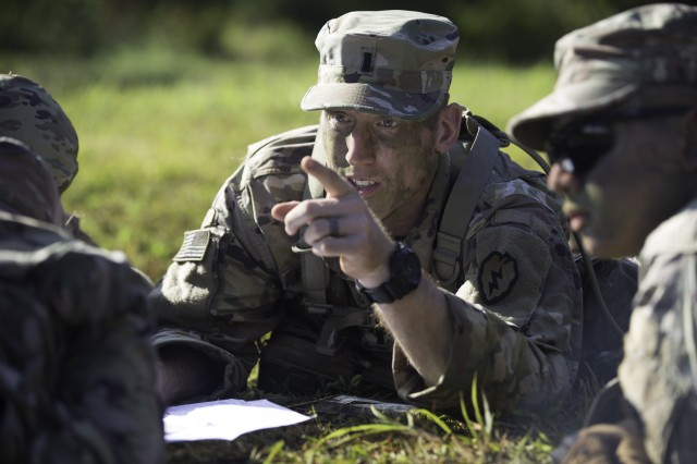 Soldiers conduct a map reconnaissance as part of the 25th ID Best FiST certification.