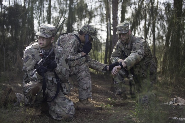 Soldiers prepare to occupy an observation post as part of the 25th ID Best FiST certification.