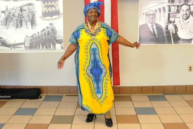 Mary Huguley, military family member, shows off a traditional outfit from Ghana.