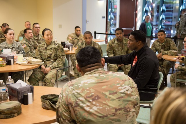 Herschel Walker carved out time to talk with Soldiers during their lunch break at Winn Army Community Hospital.