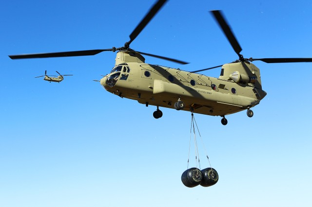 A pair of newly arrived CH-47 MY2 Chinook helicopters from the 2nd General Support Aviation Battalion, 1st Aviation Regiment, 1st Combat Aviation Brigade, 1st Infantry Division, fly near Marshall Army Airfield on Fort Riley, Kansas, Jan. 25. The new Chinooks will allow the aircraft to be more readily available to the ground force commander while also saving the Army money on maintenance costs. (Chad L. Simon, 1st Inf. Div. Public Affairs)
