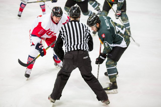 U.S. Army Maj. Michael Long prepares for a face-off at Elektrenu Ledo Arena during a game against Lithuania in the Fifth Baltic Military Winter Games Ice Hockey Tournament Jan. 24-26, 2018, in Vilnius, Lithuania. Long scored the game-winning goal for the All Army Hockey Team in the final match versus the host nation to claim gold for the U.S.