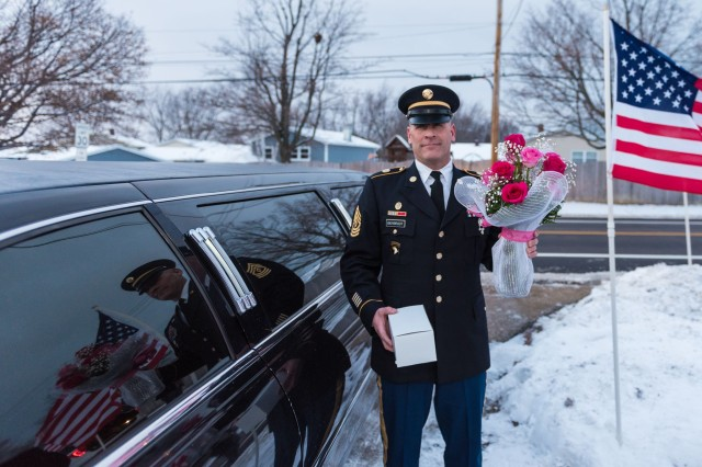 1st Sgt. Joseph Bierbrodt of Sheridan, Illinois, with the 933rd Military Police Company, arrives at the Hinton's home to ask Cayleigh Hinton if he can escort her to the Father-Daughter Dance at the Our Lady of Humility School in Beach Park, Illinois, Feb. 7., Cayleigh's father, Sgt. Terrence Hinton, died in a training accident May 14, 2017 in Hawaii. Beirbrodt along with Cayleigh and her family were taken to the dance in a limo escorted by the Patriot Guard, multiple nearby police departments and fire departments.