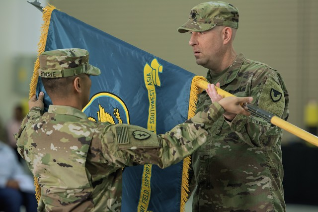 Lt. Col. Robert Mc.Kean (right), outgoing commander, Army Field Support Battalion-Southwest Asia, and his senior enlisted advisor, Master Sgt. Jaime Ednave, uncase the battalion's colors during a ceremony for the AFSBn-SWA at Camp Arifjan, Kuwait, Feb. 7. (U.S. Army Photo by Justin Graff, 401st AFSB Public Affairs)