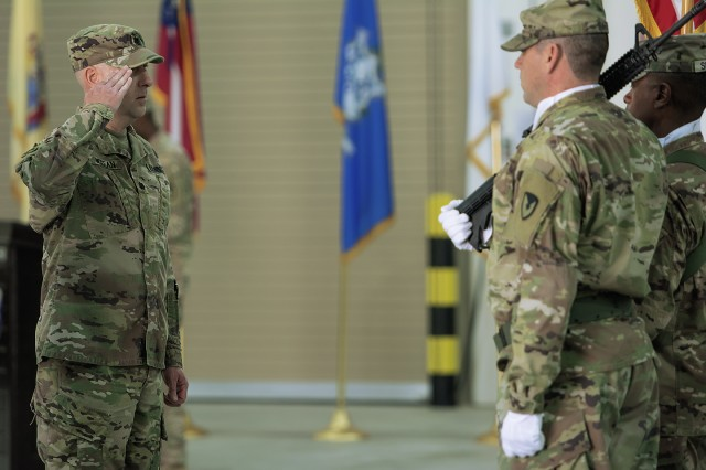 Lt. Col. Robert Mc.Kean, outgoing commander, Army Field Support Battalion-Southwest Asia, salutes the color guard during a change of command ceremony for the AFSBn-SWA at Camp Arifjan, Kuwait, Feb. 7. (U.S. Army Photo by Justin Graff, 401st AFSB Public Affairs)