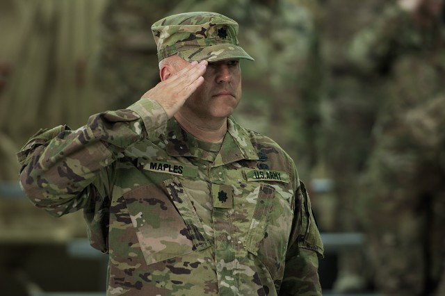 Lt. Col. Tim Maples, commander, Army Field Support Battalion-Southwest Asia, salutes during a change of command ceremony for the AFSBn-SWA at Camp Arifjan, Kuwait, Feb. 7. (U.S. Army Photo by Justin Graff, 401st AFSB Public Affairs)