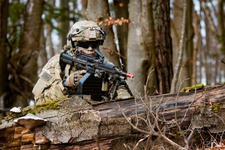 An infantryman assigned to 2nd Armored Brigade Combat Team, 1st Infantry Division, pulls security after pushing enemy opposition forces into the hills during an Allied Spirit VIII training exercise, Jan. 25, 2018, at Hohenfels Training Area, Germany.