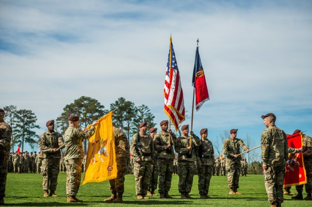 Col. Scott A. Jackson, the commander of the 1st Security Force Assistance Brigade observes as the unit unveils their colors for the first time in history during an activation ceremony at the National Infantry Museum at Fort Benning, Georgia, Feb. 8, 2016.