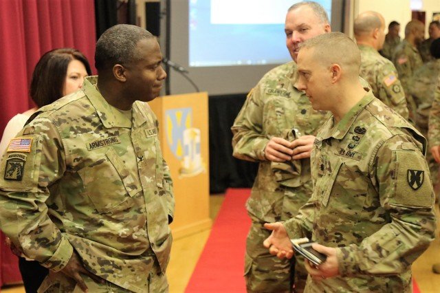 Col. U. L. Armstrong, the commander of the 773rd Civil Support Team, speaks to Lt. Col. Jason A. Berdou, commander of the 21st Special Troops Battalion, after Armstrong's speech during U.S. Army Garrison Rheinland-Pfalz African-American History Month celebration hosted by the Army Reserve's 7th Mission Support Command Feb. 9 at the Kaiserslautern Army Community Center on Daenner Kaserne.