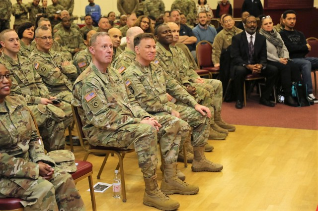 Brig Gen. Fred Maiocco, the 7th MSC commanding general and 21st Theater Sustainment Command deputy commanding general (center, left) and Col William S. Galbraith, 21st TSC deputy commanding officer (center, right) listen during the U.S. Army Garrison Rheinland-Pfalz African-American History Month celebration hosted by the Army Reserve's 7th Mission Support Command Feb. 9 at the Kaiserslautern Army Community Center on Daenner Kaserne.