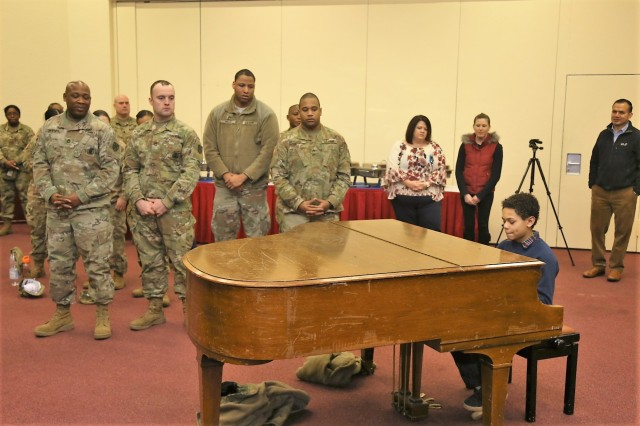 Kianta Reeves, a local youth performs two songs on the piano during U.S. Army Garrison Rheinland-Pfalz African-American History Month celebration hosted by the Army Reserve's 7th Mission Support Command Feb. 9 at the Kaiserslautern Army Community Center on Daenner Kaserne.