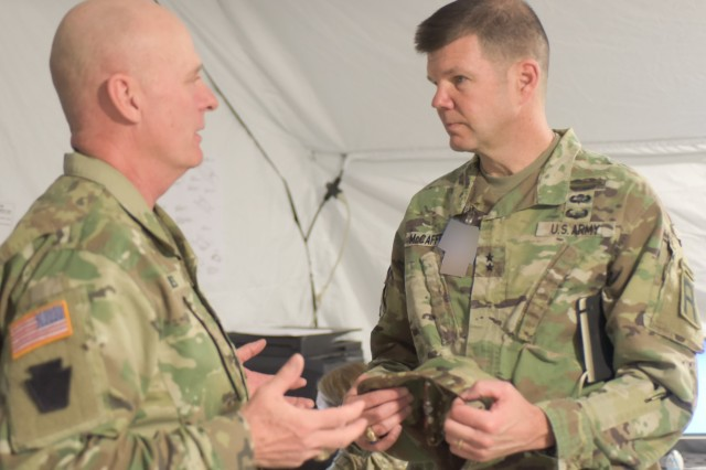 "Maj. Gen. Todd McCaffrey (right), First Army Division East commanding general, talks with Command Sgt. Maj. John Jones, command sergeant major of the Pennsylvania Army National Guard's 28th Infantry Division, during the 28th ID's culminating training exercise at Fort Hood, Texas, Jan. 31, 2018. About 500 Soldiers in the Pennsylvania unit's headquarters are preparing to deploy to the Middle East. ""(First Army personnel) have been very helpful assisting us on our way to deployment and with the validation process,"" Jones said. (Photo altered for security purposes.)"